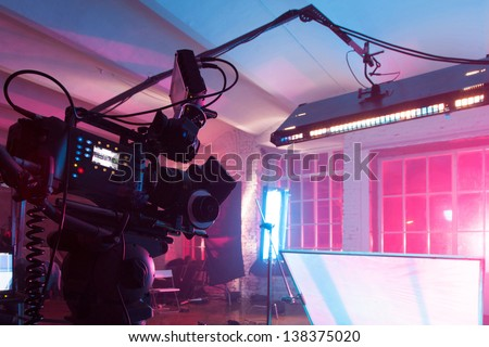 MOSCOW - OCT 24: Room in the purple light with equipment for a film on shooting video clip Rene in White Studio, on October 24, 2010 in Moscow, Russia. - stock photo