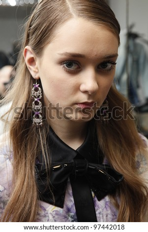 MOSCOW - OCTOBER 24: A model gets ready backstage at the Viva Vox Collection for Spring/ Summer 2012 during Volvo Fashion Week on October 24, 2011 in Moscow, Russia