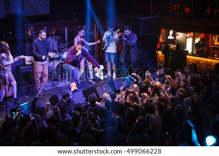 MOSCOW - 14 OCTOBER,2016: Big concert of Russian rap singer Kravz on nightclub Moskva stage.Crowded dance floor and bright concert lights on the scene