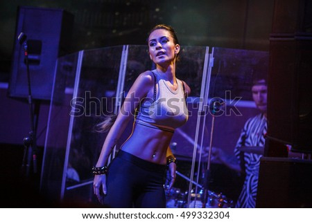 MOSCOW - 14 OCTOBER,2016: Big concert of Russian rap singer Kravz on nightclub Moskva stage.Go-go dance support on scene.Go go dancers girls dancing