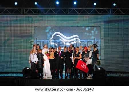MOSCOW - OCTOBER 3: Competitors and models stand on stage at Competition Wella Trend Vision Award 2010, on October 6, 2010 in Moscow, Russia.