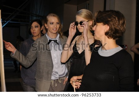 MOSCOW - OCTOBER 22: Designer Julia Nikolaeva and  Models backstage at the Julia Nikolaeva Collection for Spring/ Summer 2012 during Mercedes-Benz Fashion Week on October 22, 2011 in Moscow, Russia