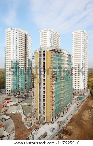 MOSCOW - OCTOBER 7: Four buildings under construction of residential complex Elk Island on October 7, 2011 in Moscow, Russia. This is 12-29 storey buildings with living area of 100 000 square meters. - stock photo
