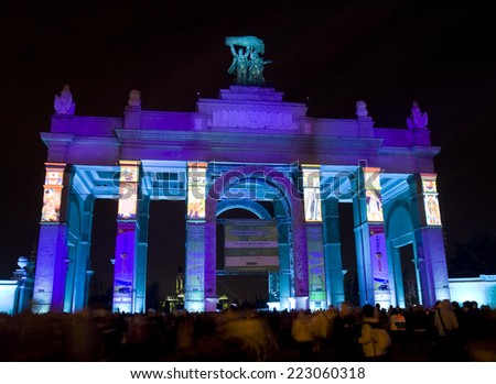 "MOSCOW - OCTOBER 11, 2014: international festival ""Circle of light"", illuminated entrance to VDNH (main Russian exhibition centre)."