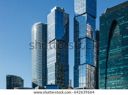 MOSCOW - 10 OCTOBER,2016 : International financial and business trading center Moscow City in Russian capital.Gigantic metal skyscrapers under bright sun.Sunlight reflect on huge building