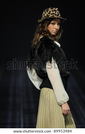 MOSCOW - OCTOBER 29: Model walks runway at the Kalinka Morozov Collection for Spring/ Summer 2012 during Volvo Fashion Week on October 29, 2011 in Moscow, Russia