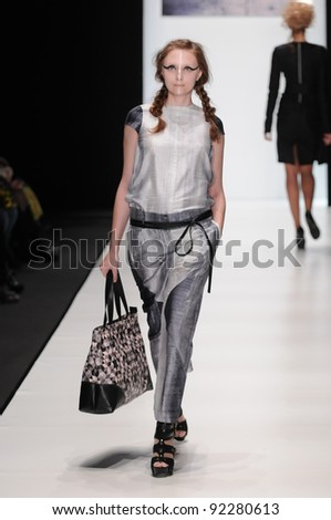 MOSCOW - OCTOBER 21: Model walks runway at the Lab 13 Collection for Spring/ Summer 2012 during Mercedes-Benz Fashion Week on October 21, 2011 in Moscow, Russia