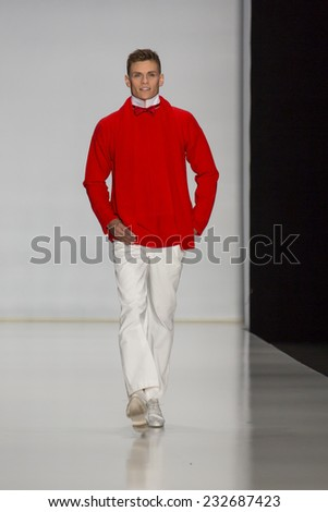 MOSCOW - OCTOBER 22: Model walks runway at the Slava Zaitsev Collection for Spring/ Summer 2015 during Mercedes-Benz Fashion Week on October 22, 2014 in Moscow, Russia