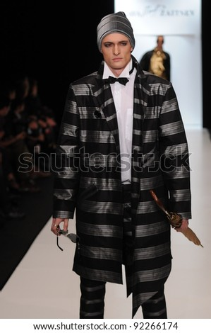 MOSCOW - OCTOBER 21: Model walks runway at the Slava Zaitsev Collection for Spring/ Summer 2012 during Mercedes-Benz Fashion Week on October 21, 2011 in Moscow, Russia