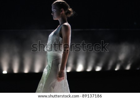 MOSCOW - OCTOBER 23: Model walks the runway at the Olga Tegin Collection for Spring/ Summer 2012 during Mercedes-Benz Fashion Week on October 23, 2011 in Moscow, Russia - stock photo