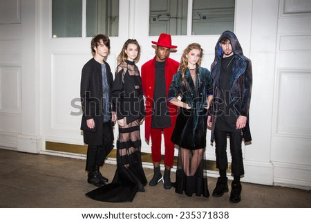 MOSCOW - OCTOBER 25: Models display creations by Russian designer Porosmani Jenya Malygina during Mercedes-Benz Fashion Week Russia on October 25, 2014 in Moscow, Russia. - stock photo