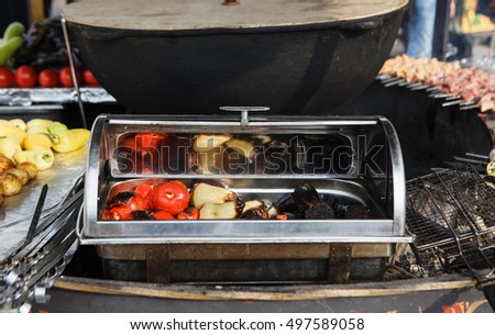MOSCOW - 3 OCTOBER,2016 : Russian national streetfood festival near Red Square.Traditional fried vegetables and meat called shashlyk.Tasty street food or fast food cooking outdoors