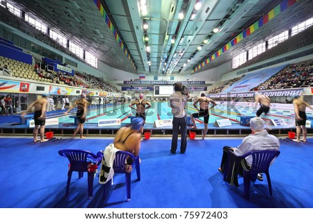 MOSCOW - OCTOBER 5: Swimmers prepare to start in swimming championship 2010 in Olympic sporting complex on October 5, 2010 in Moscow, Russia. - stock photo