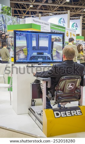 MOSCOW- OCTOBER 24:The stand simulators for logging machinery of the American company John Deere at the International exhibition LESDREVMASH on October 24,2012 in Moscow