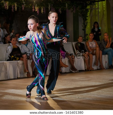 MOSCOW - OCTOBER 20: Unidentified children age 10-14 compete in latino dance on the Artistic Dance Awards 2012-2013, organized by World Dance Artistic Federation on October 20, 2013, in Moscow.
