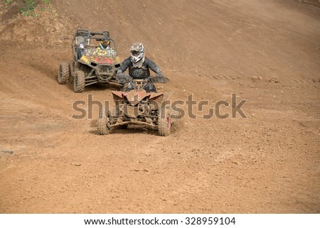 "MOSCOW-OCTOBER 10: Unidentified riders at the track, class ""ATV, UTV, 4x4"", in the 5 stage of the XSR-MOTO.RU Cross Country in Moscow, Park ""Velyaminovo""; on October 10, 2015"