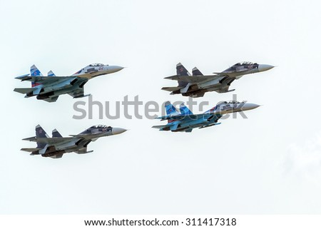 "MOSCOW REGION - AUGUST 28, 2015: Aerobatic display team ""Falcons of Russia"" on Su-27 and Su-34 at the International Aviation and Space Salon (MAKS) in Zhukovsky.