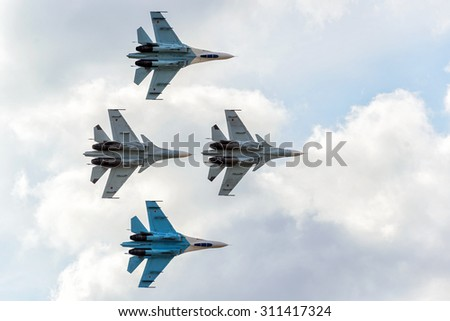 "MOSCOW REGION - AUGUST 28, 2015: Aerobatic display team ""Falcons of Russia"" on Su-27 and Su-34 at the International Aviation and Space Salon (MAKS) in Zhukovsky. - stock photo"