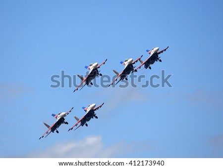 MOSCOW REGION -  AUGUST 30: Demonstrative performance of the aerobatic team of Russian military aircraft at the airshow  on August  30, 2015 in Moscow region