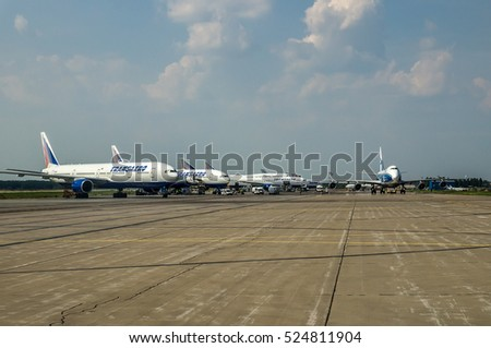 Moscow region, Domodedovo, Russia - July 04, 2013: Aerial view on airport airfield and airplanes standing on parking place on ground maintenance at Domodedovo international airport