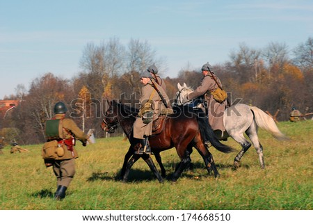 MOSCOW REGION - OCTOBER 13: Reenactors dressed as WW II Russian soldiers ride   horses on October 13, 2013 in Borodino, Moscow Region, Russia. The battle they are reenacting was the Moscow Battle.