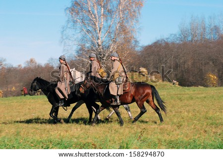MOSCOW REGION - OCTOBER 13: Reenactors dressed as WW II soldiers ride horses on October 13, 2013 in Borodino, Moscow Region, Russia. The battle he is reenacting was the Moscow Battle held in 1941.