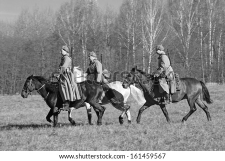 MOSCOW REGION - OCTOBER 13: Reenactors dressed as WW II soldiers ride horses on October 13, 2013 in Borodino, Moscow Region, Russia. The battle they are reenacting was the Moscow Battle held in 1941.