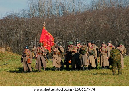 MOSCOW REGION - OCTOBER 13: Reenactors dressed as WW II soldiers stand on October 13, 2013 in Borodino, Moscow Region, Russia. The battle they are reenacting was the Moscow Battle held in 1941.
