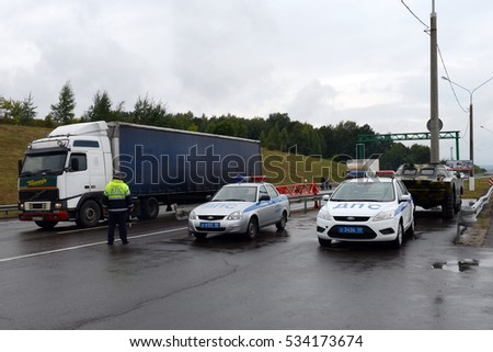 "MOSCOW REGION, RUSSIA - AUGUST 27,2014: Inspectors of traffic police of police on the route ""Don""."
