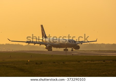 Moscow region, Russia - May 27, 2014: Airbus A330 landing at Sheremetyevo international airport at sunset