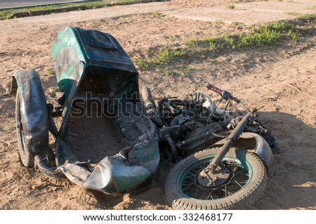 Moscow region, RUSSIA - May 31, 2011: Ural motorbike being run over by a tank