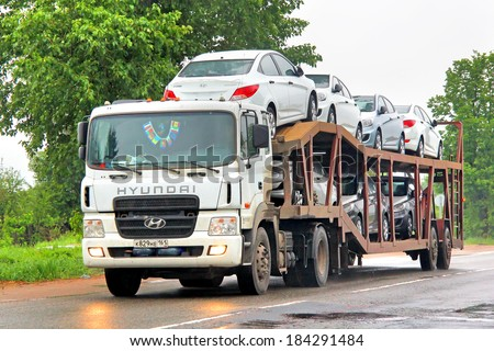 MOSCOW REGION, RUSSIA - MAY 22, 2013: White Hyundai HD500 semi-trailer truck at the interurban road.