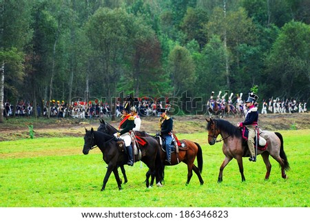 MOSCOW REGION, RUSSIA - SEPTEMBER 02, 2012: Reenactors dressed as Napoleonic war soldiers fight on the battlefield. The battle they are reenacting was the Borodino battle held in 1812.