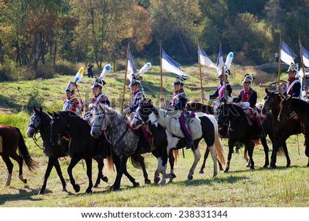 MOSCOW REGION - SEPTEMBER 07, 2014: Reenactors dressed as Napoleonic war soldiers ride horses at Borodino battle historical reenactment.