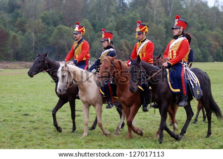 MOSCOW REGION - SEPTEMBER 02: Unknown soldiers in red uniform at Borodino historical reenactment battle at its 200 anniversary. Taken on September 02, 2012 in Borodino, Moscow Region, Russia.
