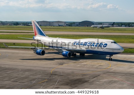 Moscow region, Sheremetyevo airport, Russia - June 15, 2013: Boeing 747-400 Transaero EI-XLJ taxiing to terminal while Airbus A330 Aeroflot VQ-BCQ landing at Sheremetyevo Internatioanl airport. - stock photo