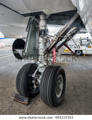 Moscow region, Vnukovo, Russia - September 09, 2016: Close-up view of main landing gear of  Sukhoi Superjet 100 RA-89067 shown during Jetexpo-2016 at Vnukovo international airport.