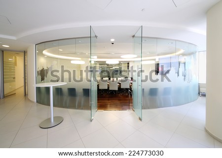 MOSCOW, RUSSIA - APR 10, 2014: Glass walls and open door to empty conference room in office of Moscow Exchange - stock photo