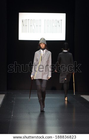 MOSCOW, RUSSIA - APR 03, 2014: Moscow Fashion Week in Gostiny Dvor. Demonstration models of clothes on the catwalk from French designer Natasha Drigant