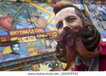 MOSCOW,RUSSIA - APR 04: Participant of the third All-Russian championship of beards and mustaches stays on public place in center Moscow on 04 of April 2015, Russia - stock photo