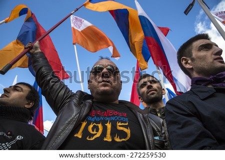 MOSCOW,RUSSIA - APR 24: People holding a Armenian flags in Moscow Gorky park to mark the 100th anniversary of the Armenian genocide in the Ottoman Empire on 1915 year in Moscow on 24 of April 2015 - stock photo
