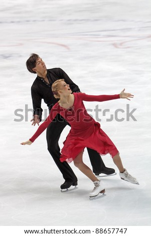 "MOSCOW, RUSSIA - APR 30: World championship on figure skating 2011. Ekaterina Bobrova and Dmitri Soloviev in pair ice dance. Palace of sports ""Megasport"" on April 30, 2011 in Moscow."