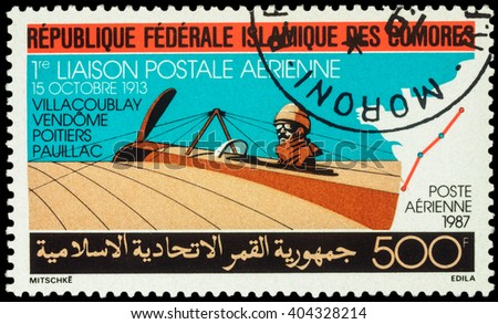 "MOSCOW, RUSSIA - APRIL 11, 2016: A stamp printed in Comoros shows old airplane Morane Saulnier Type H, devoted to the 1st Airmail Flight in 1913, series ""Airmail - Aviation"", circa 1987 - stock photo"