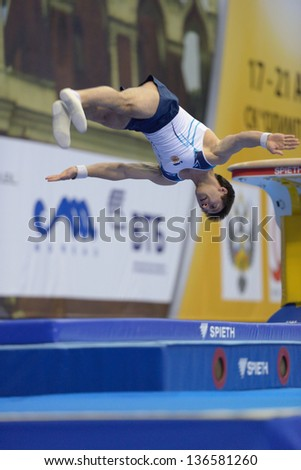 MOSCOW, RUSSIA - APRIL 21: Artur Davtyan, Armenia performs vault in final of 5th European Championships in Artistic Gymnastics in Moscow, Russia on April 21, 2013 - stock photo