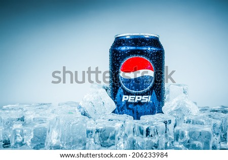 MOSCOW, RUSSIA-APRIL 4, 2014: Can of Pepsi cola on ice. Pepsi is a carbonated soft drink that is produced and manufactured by PepsiCo. Created and developed in 1893. - stock photo