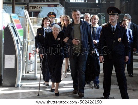 MOSCOW, RUSSIA - APRIL 21, 2014:Chairman of the Moscow Helsinki group Lyudmila Alekseeva checks the security level of the Kiev railway station in Moscow.