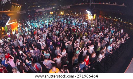 MOSCOW, RUSSIA - APRIL 5, 2014: Crowd of people at the nightclub Stadium Live during trance festival TRANSMISSION, aerial view. This festival is held for more than 10 years - stock photo