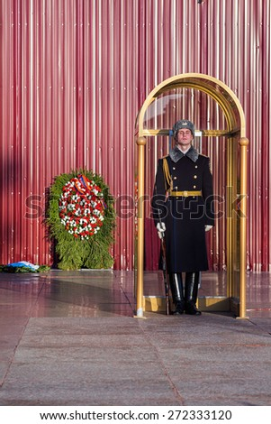 MOSCOW/RUSSIA - APRIL 10: Military student stands in sentry box in guard in honor of grave of the Unknown Soldier and The Eternal Flame on April 10, 2015 in Moscow.    - stock photo