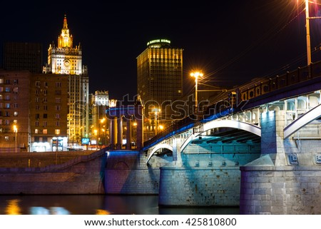 MOSCOW, RUSSIA - 7 APRIL 2016: Ministry of Foreign Affairs of Russia and Hotel Golden Ring on the Smolenskaya Square, View from Borodinsky Bridge over the Moskva river at nighttime