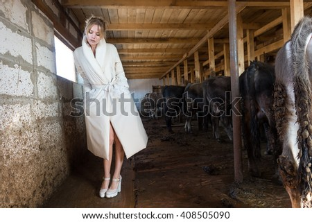 MOSCOW, RUSSIA - APRIL 04, 2016: Model walk runway in wooden barn for Jana Nedzvetskaya  show - What thinks about fashion the dead rabbit - at Fall 2016, in village Gorky.